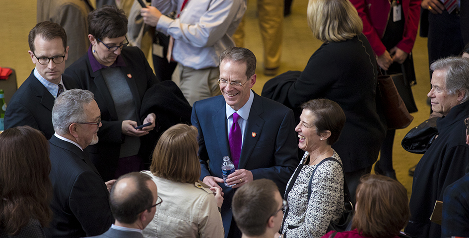 Geoffrey Mearns with faculty and staff