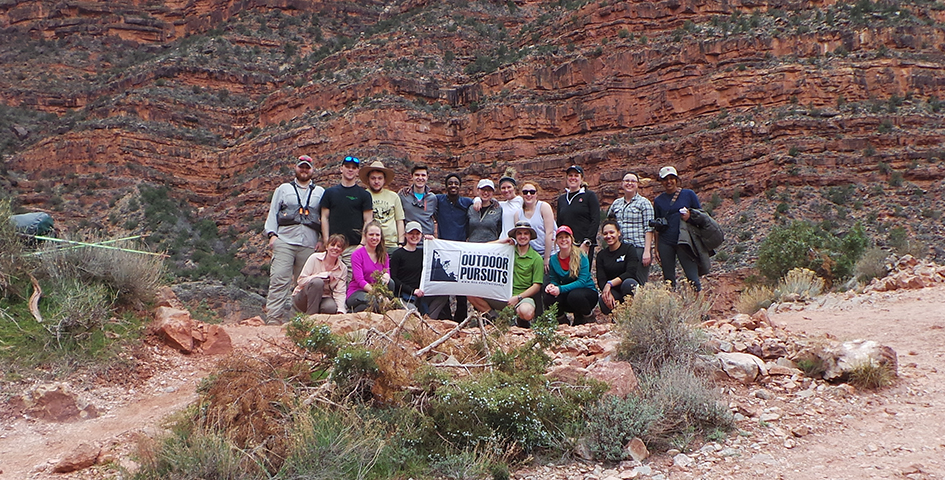 Group of students holding a sign for Outdoor Pursuits