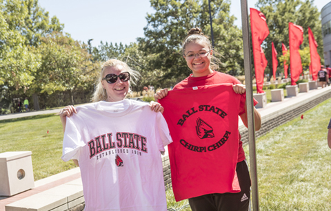 Students hold up their new BSU shirts