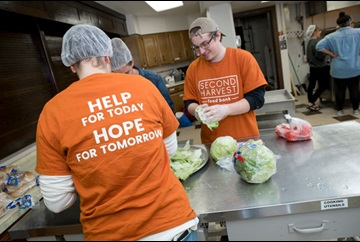 students preparing food in the Second Harvest Food Bank kitchen