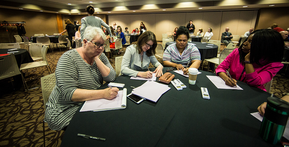 faculty and staff work together at Focus on Student Success forum