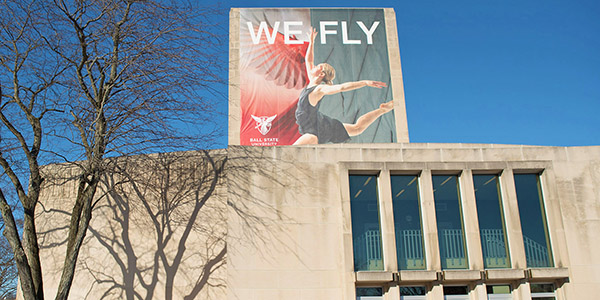 Teachers College Building with 'We Fly' banner