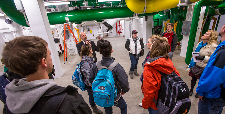 Jim Lowe gives students a tour of the geothermal system