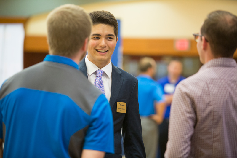 Male student in speaking with peers