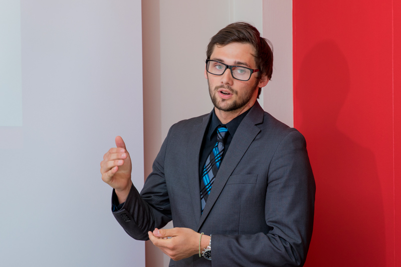 A male student presenting in class