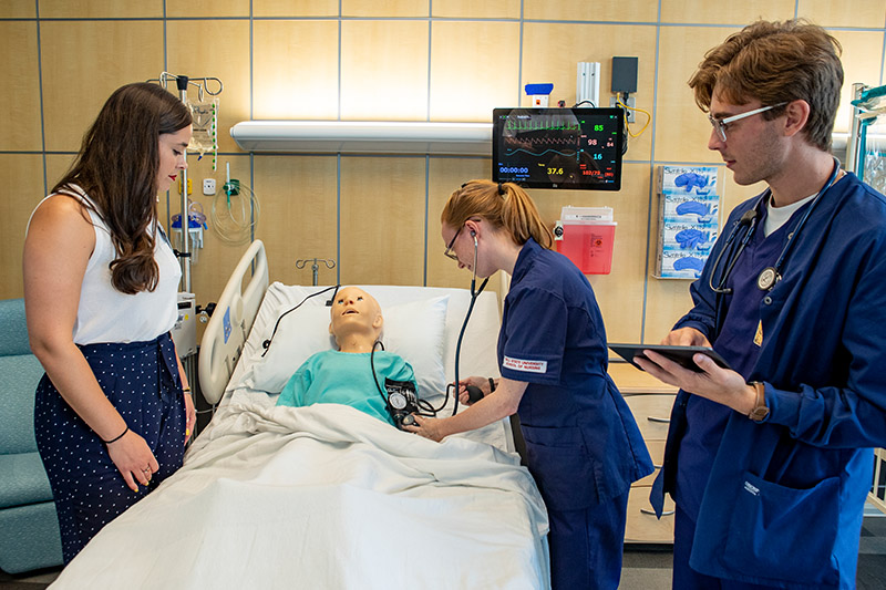 Nursing students work together in the Pediatric Simulation Lab