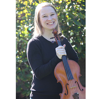 Andrea Priester Houde holding her viola