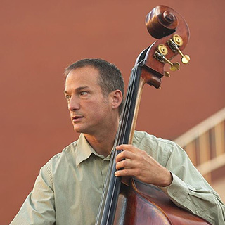 Michael Cameron playing his double bass