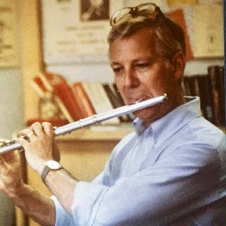 Professor Paul Boyer playing flute
