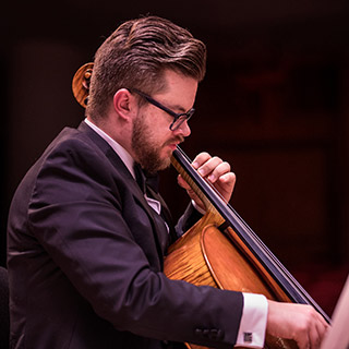 a cellist performing