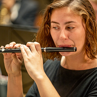 A female flutist performing