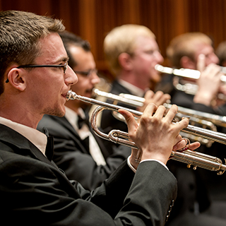 Male brass musicians performing