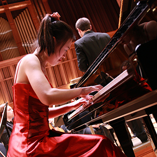 a piano soloist performing with orchestra