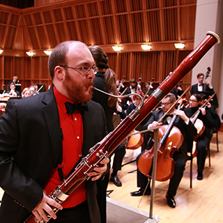 a bassoon soloist performing with orchestra