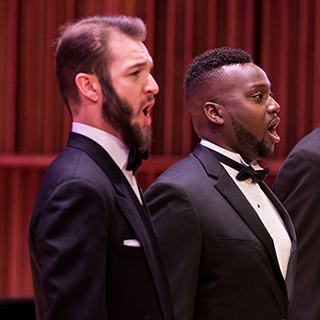Choir members performing on stage