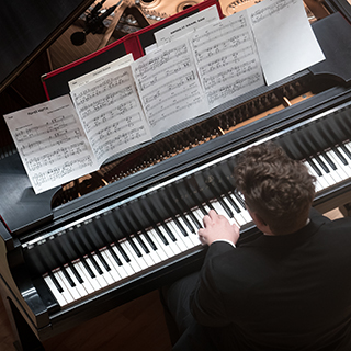 Jazz pianist performing on stage