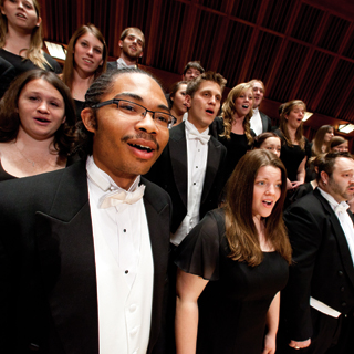 A diverse group of students singing on a choir concert