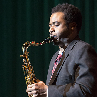 Saxophonist performing a solo on stage
