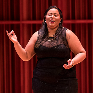 A vocal soloist performing on stage