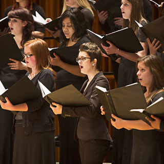 Choral musicians performing on stage
