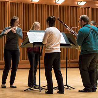 A woodwind chamber group performing on stage