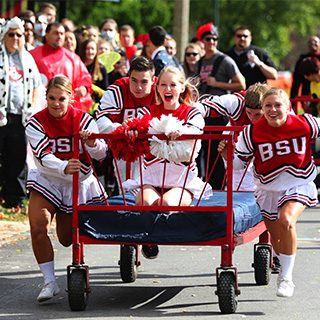 Students participate in the Homecoming bed race.