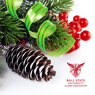 An arrangement of holiday swag with a red Ball State Alumni Association logo