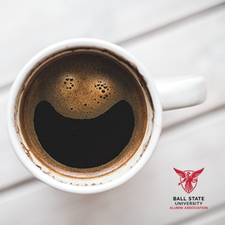 A cup of smiling coffee on a white background