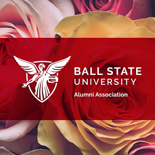White Alumni Association logo on top of a red box on top of a bed of multicolored roses