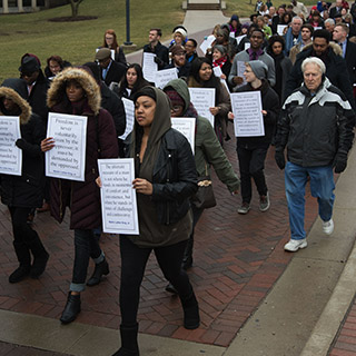 Students and community members march at the MLK Unity Walk