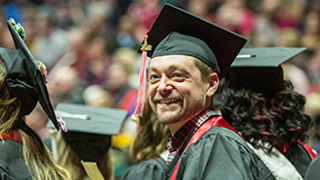 A graduate at Ball State's commencement ceremony