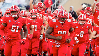 Ball State football players running out onto the field