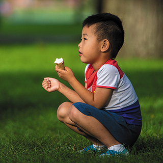 Little boy eating an ice cream cone