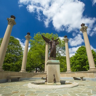 Beneficence statue in spring