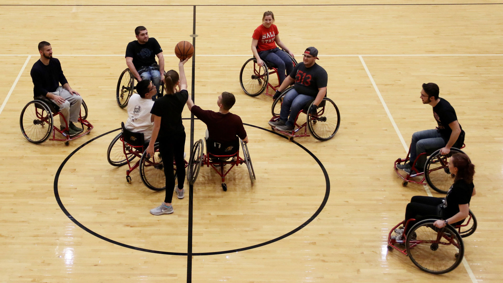 Students play basketball in wheelchairs