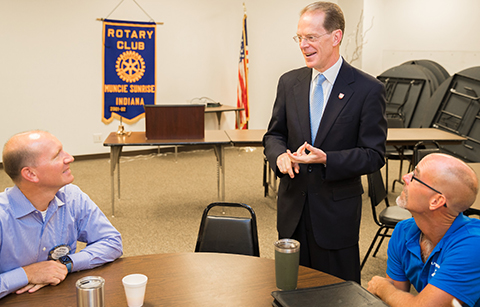 President Geoffrey S. Mearns with Rotary Club