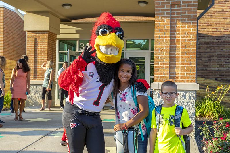 Charlies Cardinal with students
