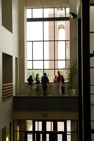 Visitors take in the view from the second floor landing inside the David Letterman Communication and Media Building