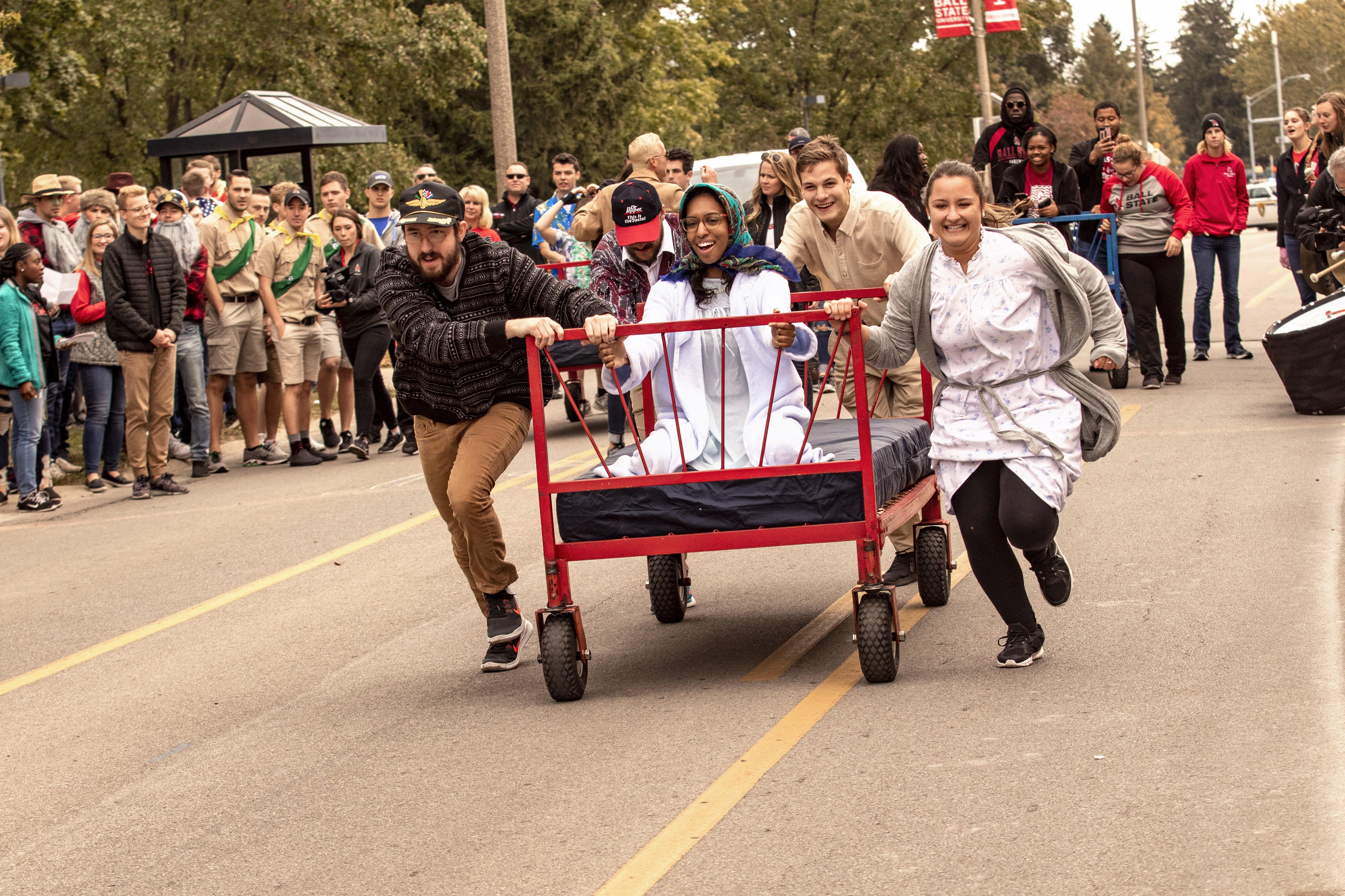 Students participating in bed races during Homecoming 2018