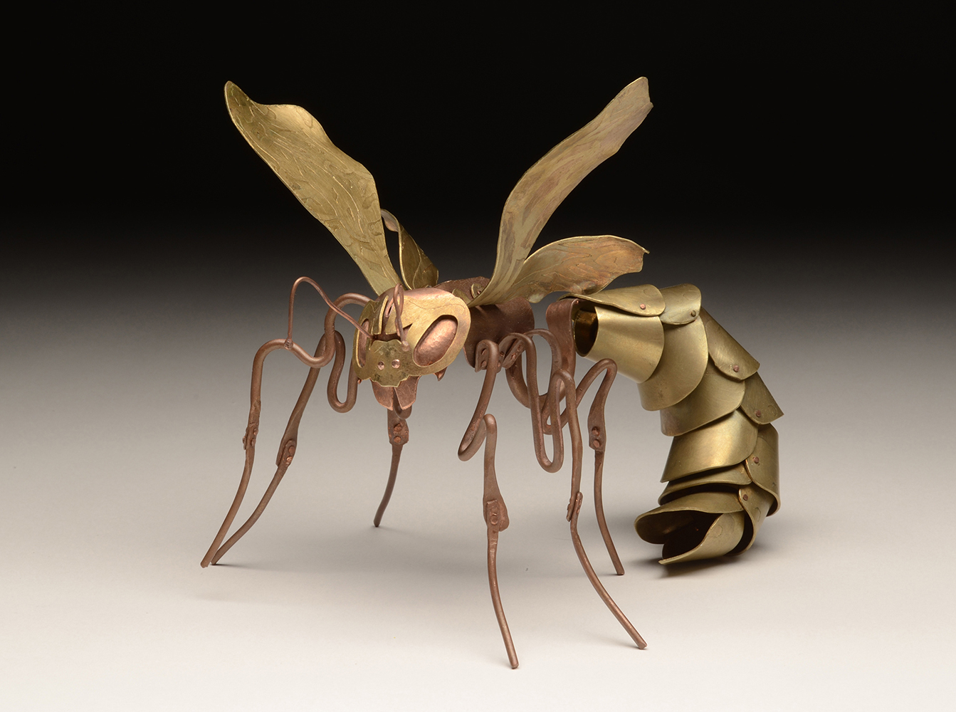 metal sculpture of a wasp
